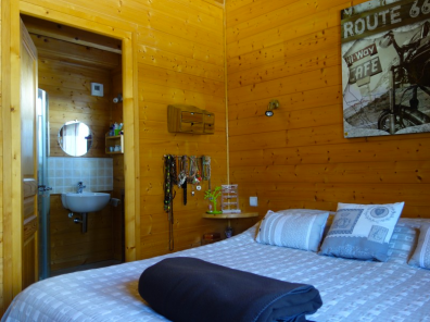 Guest bedroom within 6 bedroom chalet